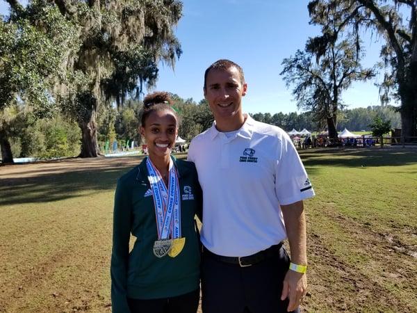 Tsion Yared 20 and Coach Paul Baur